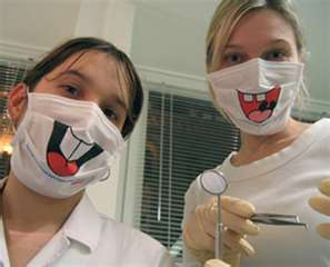 Dentist-w-assistant-in-awful-masks